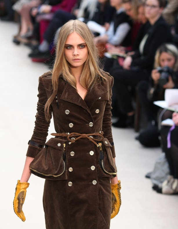 Cara Delevingne on the catwalk during the Burberry Prosum catwalk show in February 2012 (Gareth Fuller/PA)