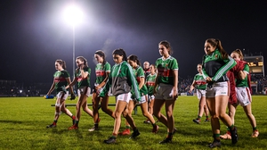 Mayo players leave the field following the defeat to Dublin