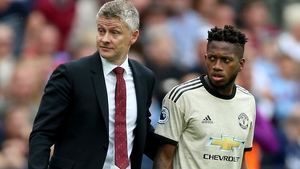 Manchester United manager Ole Gunnar Solskjaer (L) with Fred (right)