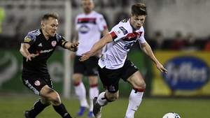 Cammy Smith of Dundalk in action against Conor McCormack of Derry City