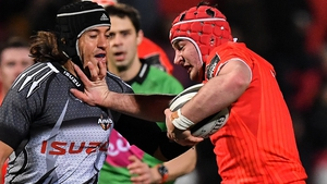 John Hodnett fends off Demetri Catrakilis to score a try on his Munster debut