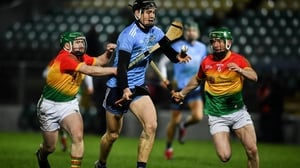 Dublin's Ronan Hayes hassled in possession by Carlow's Gary Bennett and David English