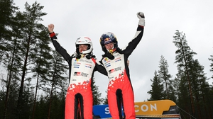 Elfyn Evans (R) celebrates with his co-driver Scott Martin