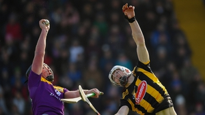 Conor McDonald of Wexford wins possession ahead of Huw Lawlor of Kilkenny