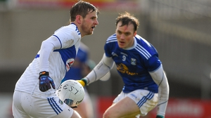 Mark Timmons of Laois in action against Cavan's Gearóid McKiernan