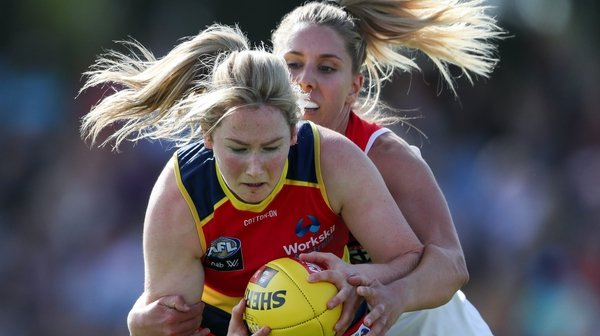 Ailish Considine of the Crows is tackled by St Kilda's Hannah Priest