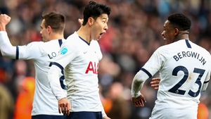 Son Heung-min (centre) celebrates his dramatic winner