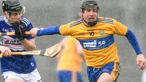 Clare forward David Reidy in action against Laois' James Keyes