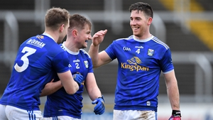 Cavan players Padraig Faulkner, Stephen Murray and Killian Brady celebrate