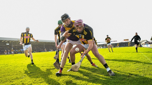 Ciaran Wallace of Kilkenny is tackled by Joe O'Connor of Wexford