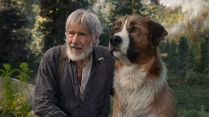 Harrison Ford as John Thornton and his beloved dog Buck in The Call of the Wild