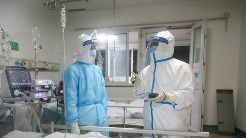 China reports drop in coronavirus cases; scientists warn virus may spread easily
