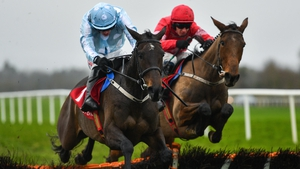 Elfile, with Danny Mullins on board, jumps clear at the last