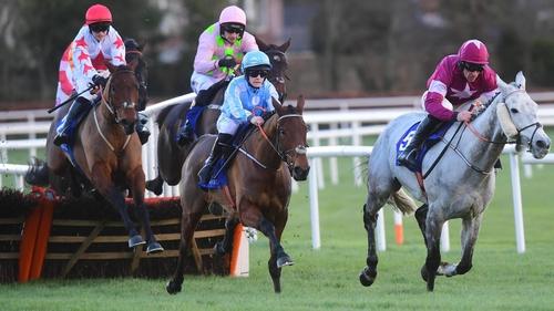 Honeysuckle (light blue) going on to win the 2020 Irish Champion Hurdle