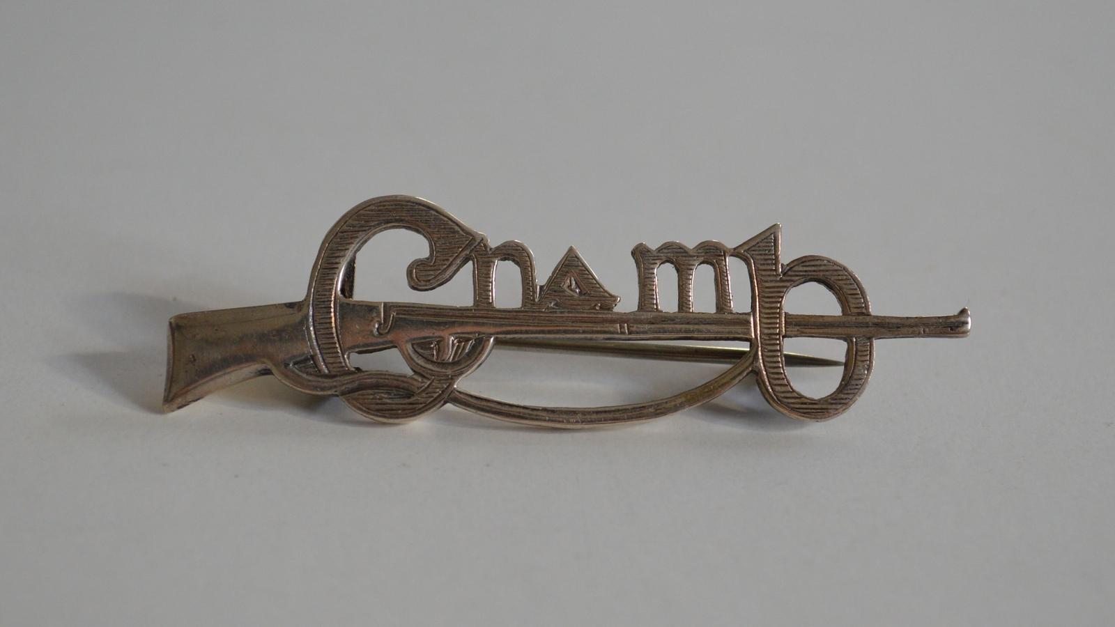 Image - A Cumann na mBan pin. Image courtesy of Kilmainham Gaol Museum, KMGLM 2011.0344