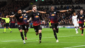 Timo Werner cups his ear as Tottenham's fans fall silent after his 58th-minute penalty