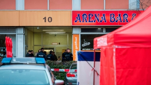 Police are seen outside the Arena Bar where one of the shootings took place