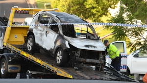Police remove the Baxter family's vehicle from the scene in Brisbane