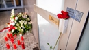 A rose is seen on the door handle at the entrance to Arena Bar and Kiosk for the victims of the Hanau shooting