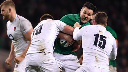 Jonathan Sexton is tackled by Owen Farrell (10) and Elliot Daly (15) of England during the 2019 Six Nations