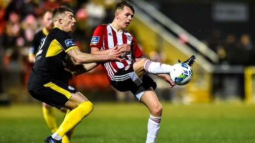 Ciaron Harkin of Derry City in action against Sam Todd of Finn Harps