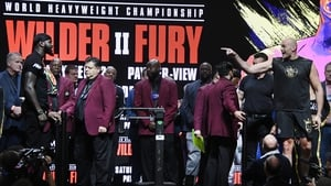 Tyson Fury (R) and Deontay Wilder were kept apart at last night's weigh-in