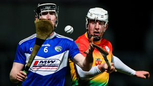 John Lennon of Laois in action against Kevin McDonald