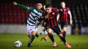Alex Dunne of Shamrock Rovers II (L) and Longford's Aaron McNally battle for possession