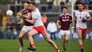 Cillian McDaid of Galway is tackled by Brian Kennedy of Tyrone