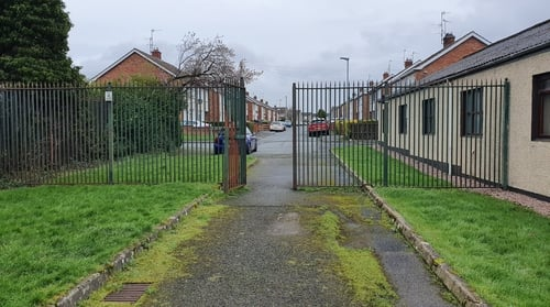 The 2.4m-high steel railing fence and gates were erected at Margretta Park in Lurgan in 1999