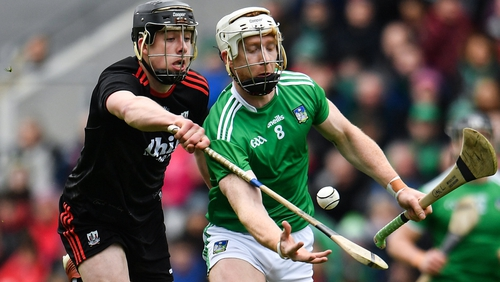 Robert Downey of Cork attempts to tackle Limerick's Cian Lynch