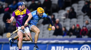 Liam Rushe of Dublin is tackled by Kevin Foley of Wexford