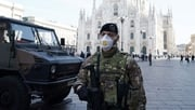 An Italian soldier stands guard in Duomo Square in Milan, Italy, today