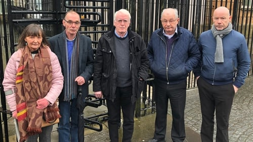 The siblings of Bloody Sunday victim James Wray, Margaret and Liam; brother of victim Michael Kelly, John; and brothers of victim William McKinney, Mickey and John outside Derry Magistrates' Court