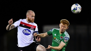 Chris Shields of Dundalk gets there ahead of Alec Byrne of Cork
