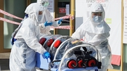 A patient suspected of carrying the coronavirus arrives at Kyungpook National University Hospital in Daegu, South korea