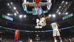 Giannis Antetokounmpo #34 of the Milwaukee Bucks dunks during the first half