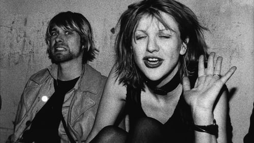 Kurt Cobain and Courtney Love pose on the VIP balcony during a Mudhoney concert at the Hollywood Palladium on December 4, 1992 in Los Angeles