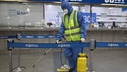 A worker sprays disinfectant at a railway station in Daegu, South Korea