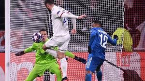 Lyon's Lucas Tousart (C) scores the opening goal