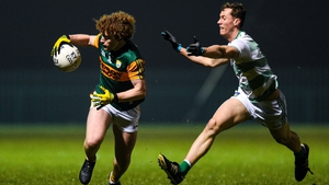Paul Walsh of Kerry in action against James Cummins of Limerick
