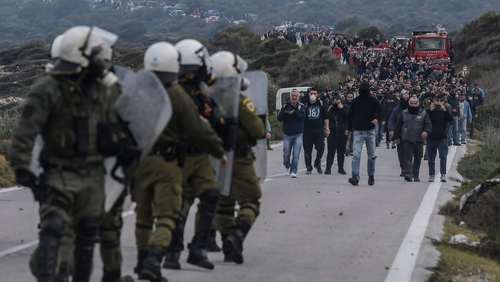 Greek riot police face demonstrators during protests against the construction of a new migrant camp on Lesbos