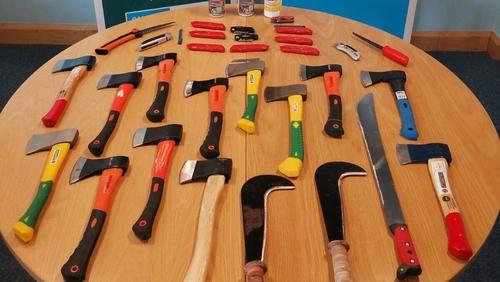 A machete and hatchets were among the weapons seized (Photo: PSNI)