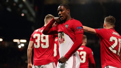 Odion Ighalo lifts his shirt to reveal a tribute to his sister while celebrating after scoring his first Manchester United goal