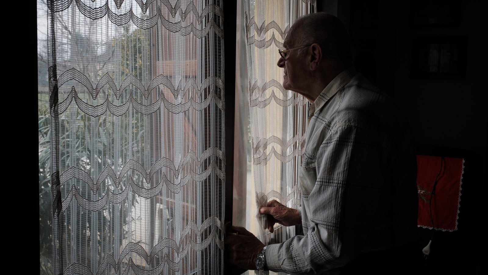 Image - Marzio's grandfather looks out at an empty street