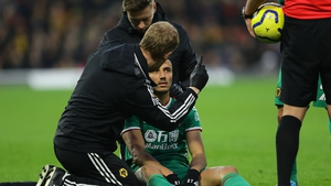 Romain Saiss of Wolverhampton Wanderers is tested for concussion after a clash