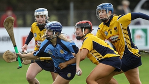 Gailltír's Annie Fitzgerald (in blue) takes on the Clonduff defence