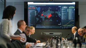Members of Germany's emergency task force sit down for a coronavirus briefing