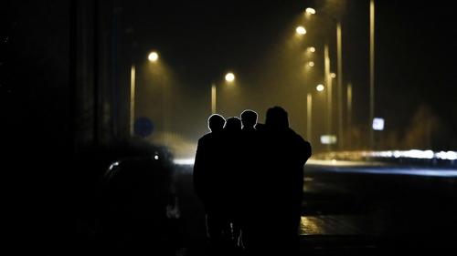 Refugees walk on a road near the Greek-Turkey border crossing of Kastanies