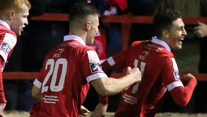 Jaze Kabia (right) leads the celebrations after firing Shelbourne in front